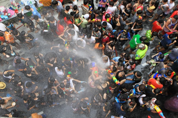 People celebrating the Songkran New Year Festival in Bangkok, Thailand.