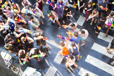People celebrating the Songkran festival or Thai New Year's festival on Silom street in Bangkok, Thailand.