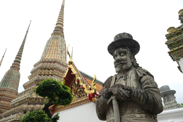 huge chiseled statues decorating the gates and doors of the temple Wat Pho Bangkok Thailand