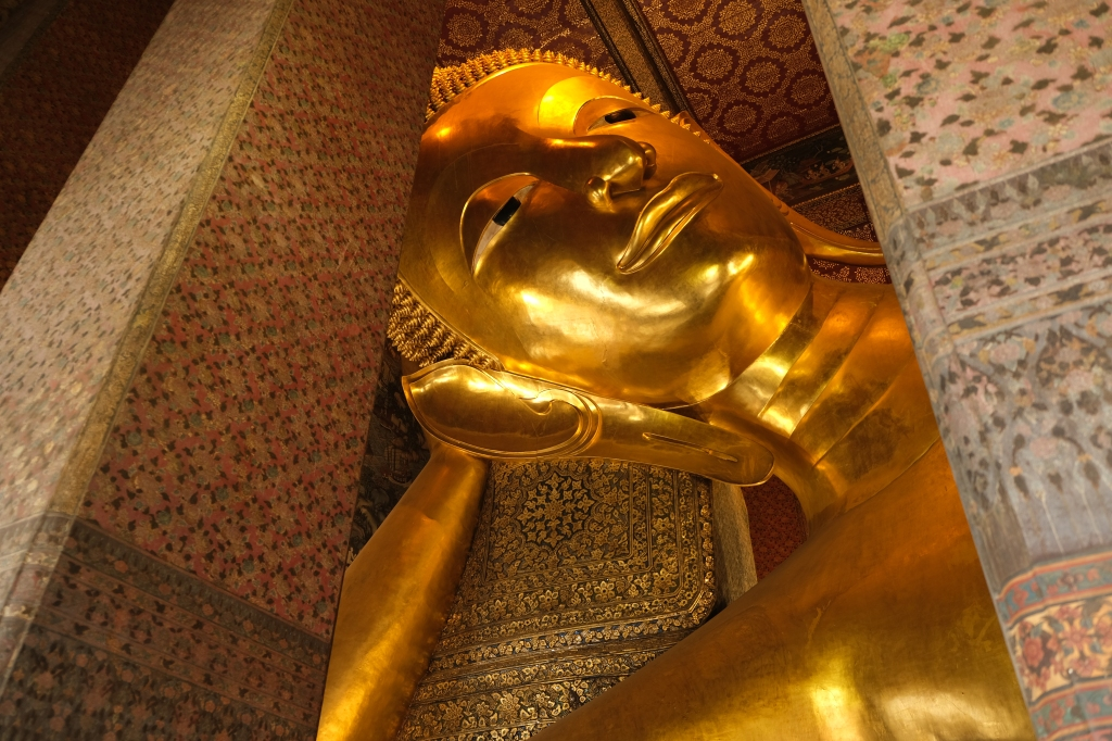 The giant reclining buddha in Wat Pho Bangkok Thailand